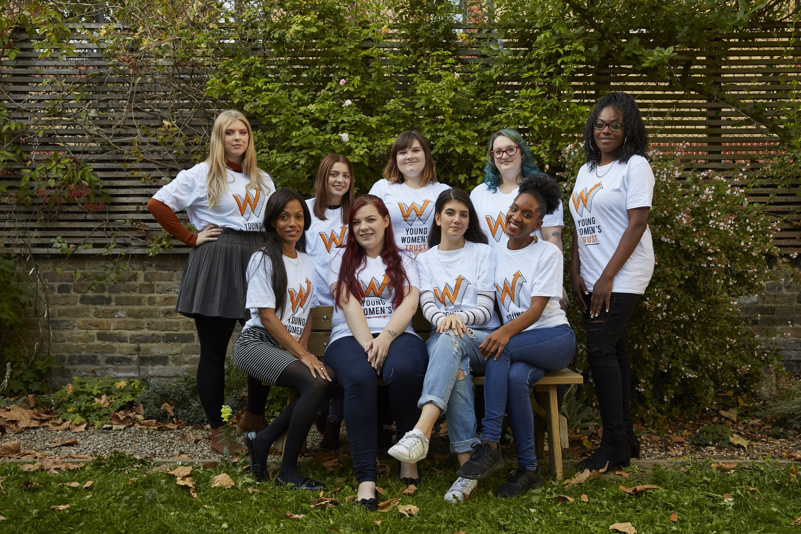 A group of women wearing Young Womens Trust t-shirts