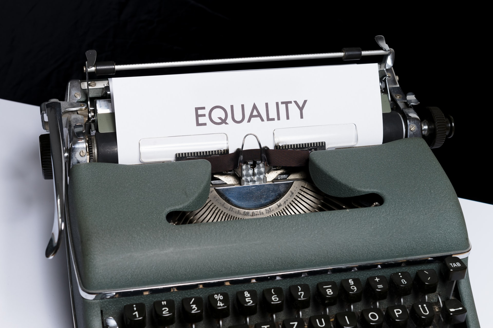Typewriter with paper that says equality