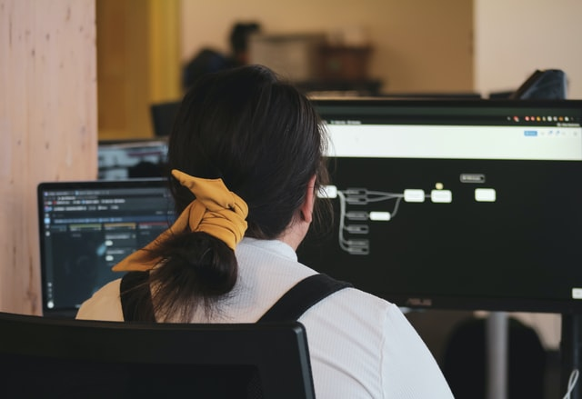 Woman coding at a computer
