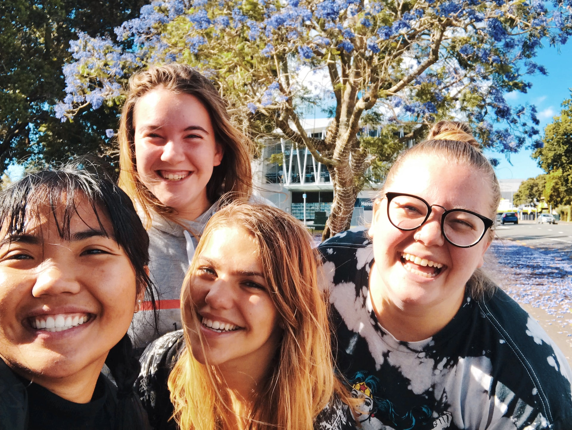 Four young women taking a selfie in the sunshine